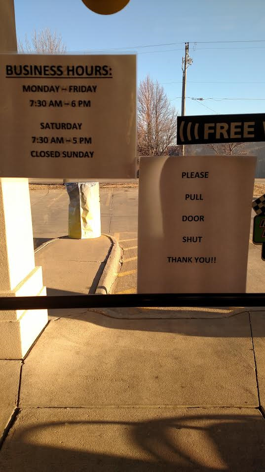 tuffy-signs-on-door